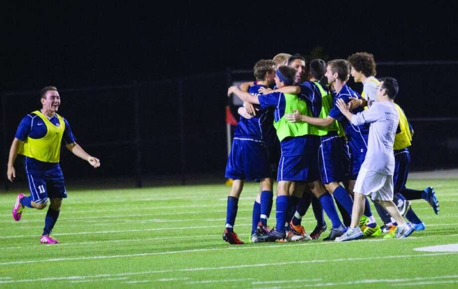 Tomball Memorial celebrates after defeating Tomball 1-0 during a boys soccer game at The Woodforest Bank Stadium in Shenandoah Friday. To view or purchase this photo and others like it, visit HCNpics.com. Photo: Staff Photo By Ana Ramirez