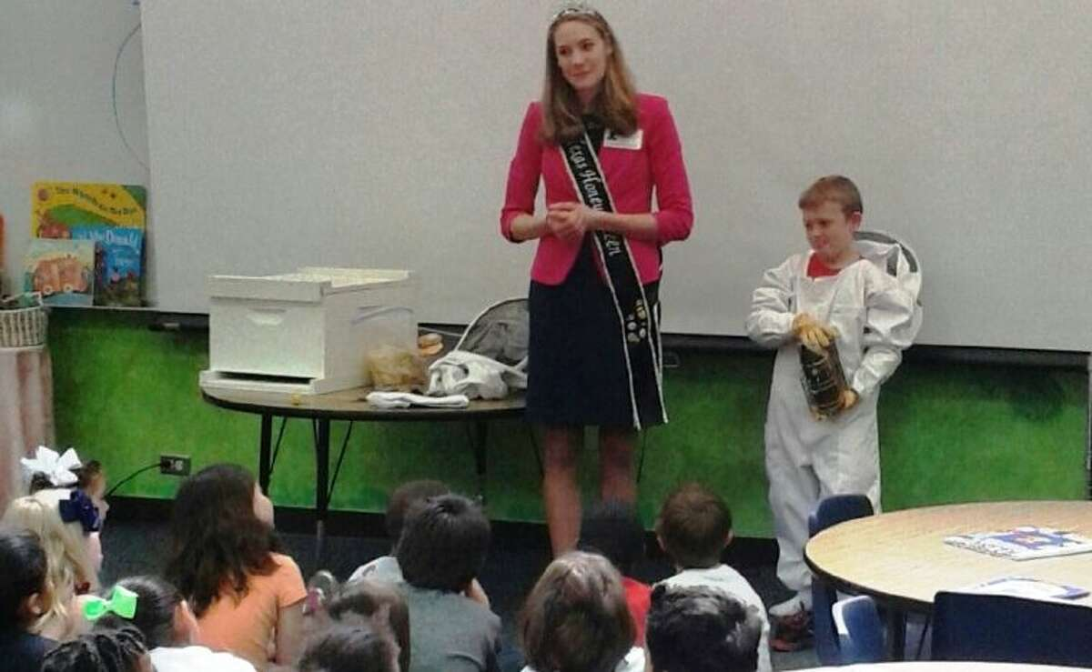 Texas Honey Queen Hayden Wolf spoke to Rice Elementary second-graders Monday about beekeeping. With her is junior beekeeper Nike Shearn, 8, who has been beekeeping for two years.