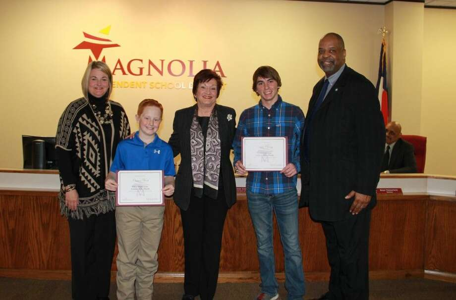 Principal Felinski with Carson Hart, School Board President Deborah Rose Miller, Caleb Cherry with Principal Frederick. Photo: MISD