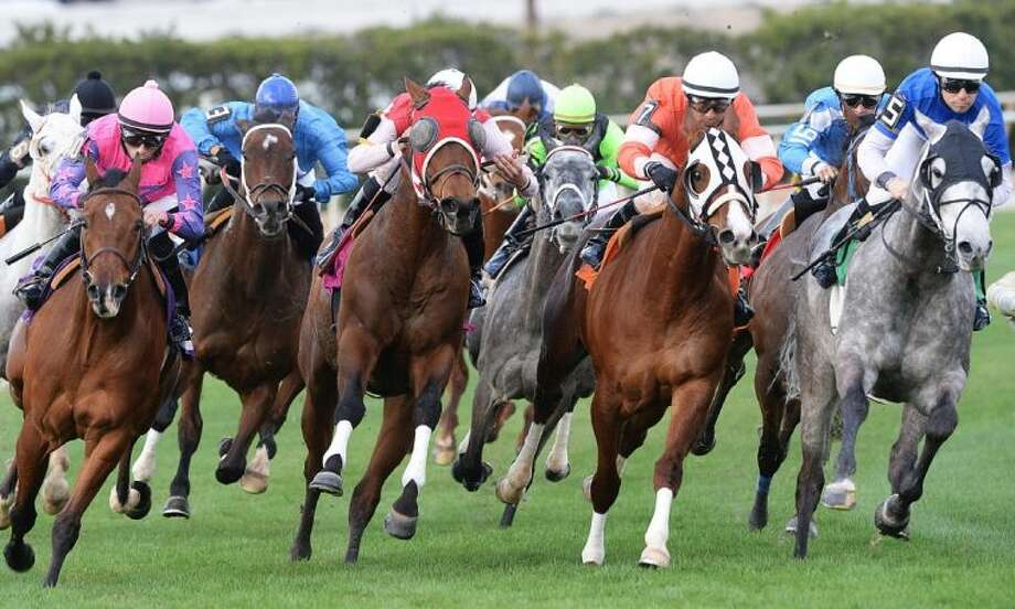 "HERE entertainment magazine hosts its first ""A Wine Tasting at the Track"" at the Sam Houston Race Park on April 5. Enjoy sampling a variety of wines before live horse racing at the park."