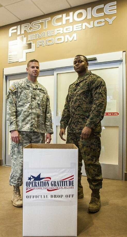 U.S. Army Staff Sgt. Robert Eudy and U.S. Marines Lance Corporal Christopher Moses.