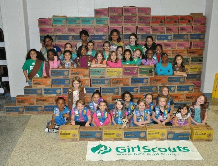 Girl Scouts from Tomball Tropp 13514 recently doubled the number of cookies shipped through Cookies2Soldiers. They shipped 1,978 packages to troops with the help of Cypress Cares. Photo: Submitted