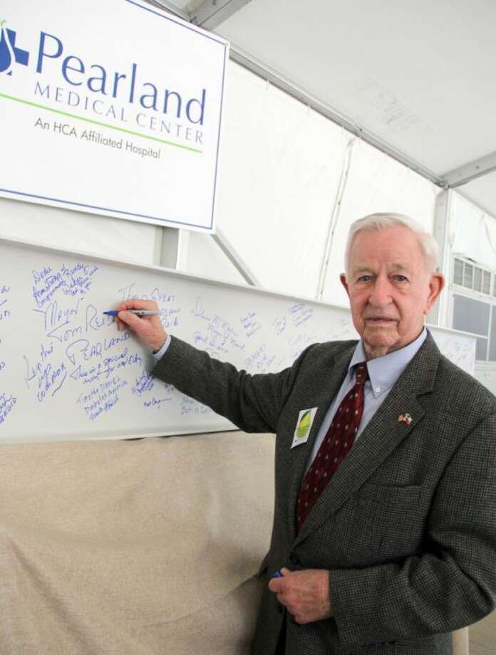Pearland Mayor Tom Reid was among those invited to sign a steel beam to be incorporated into HCA Affiliated Pearland Medical Center facility currently under construction. A celebration was held to mark another construction milestone for the 144,000 square-foot facility Wednesday (April 2). Photo: KRISTI NIX