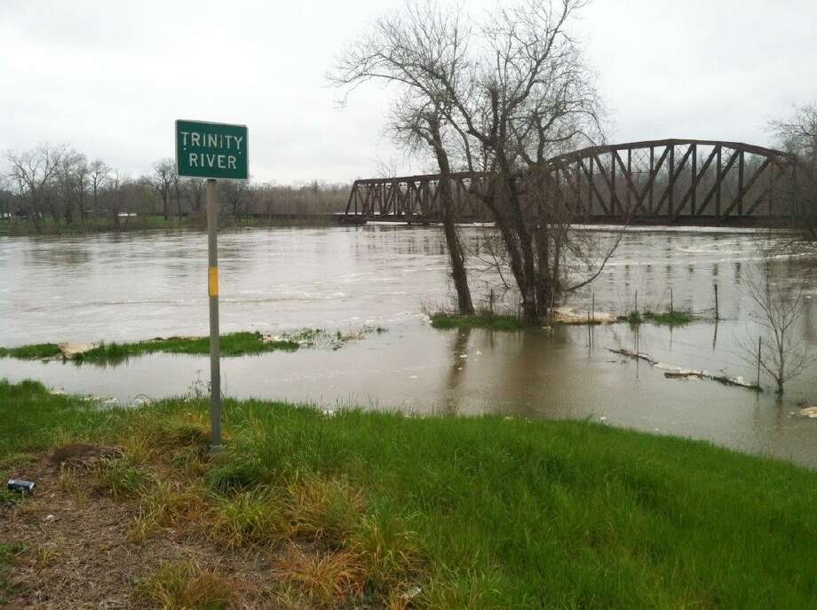 Only a few feet remain between the Trinity River and a railroad trestle over it at the US 90 bridges between Liberty and Dayton. Recent rains and releases from the Lake Livingston dam have the river swelling beyond its banks.