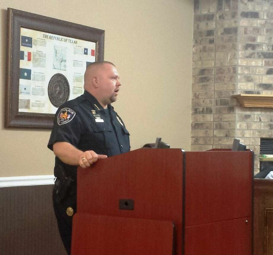 Roman Forest Police Chief Stephen Carlisle addressed the audience and council members on the topic of permitted outdoor burning on March 10.