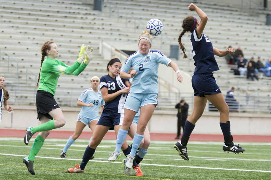 Kingwood's Sloane Scharold (2) attempts to head the ball into the goal during Kingwood's 2-0 victory over College Park on March 13, 2015, at Turner Stadium in Humble. Photo: ANDREW BUCKLEY