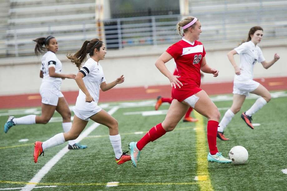 The Woodlands' Grace Piper breaks through the defense against Summer Creek on Friday at Turner Stadium in Humble.