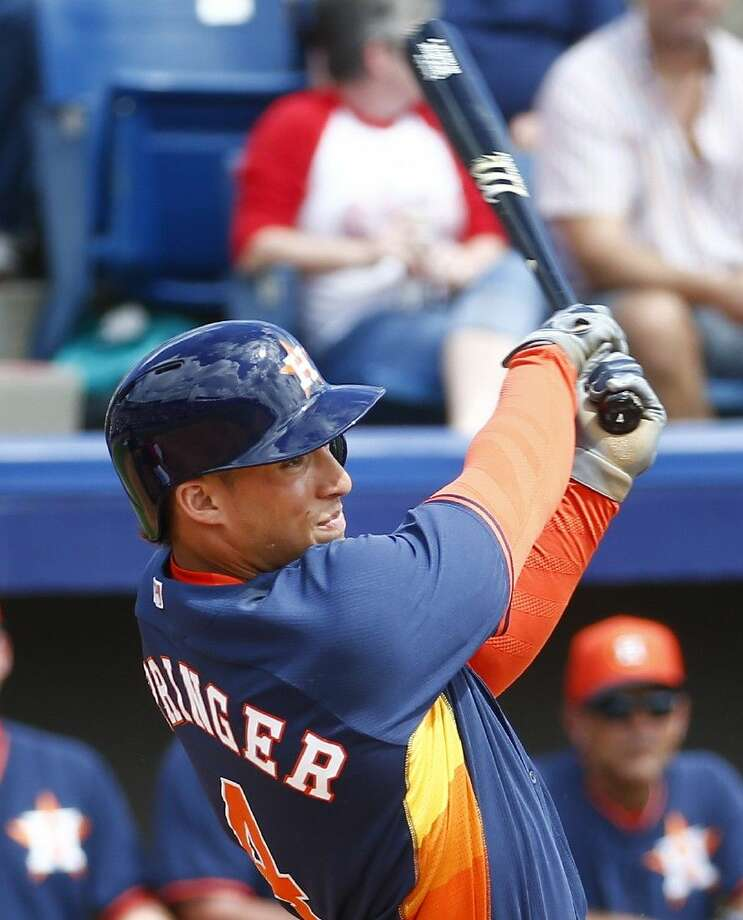 Houston Astros right fielder George Springer (4) follows through with a home run in the third inning of an exhibition spring training baseball game Washington Nationals Friday in Viera, Fla.