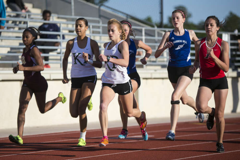 Kingwood Park's Courtney Broussard competes in the Girls 800 Meter Run during the District 19-4A and 13-5A Championship track meet on April 9, 2014, at Turner Stadium in Humble. (Photo by ANDREW BUCKLEY/The Observer)