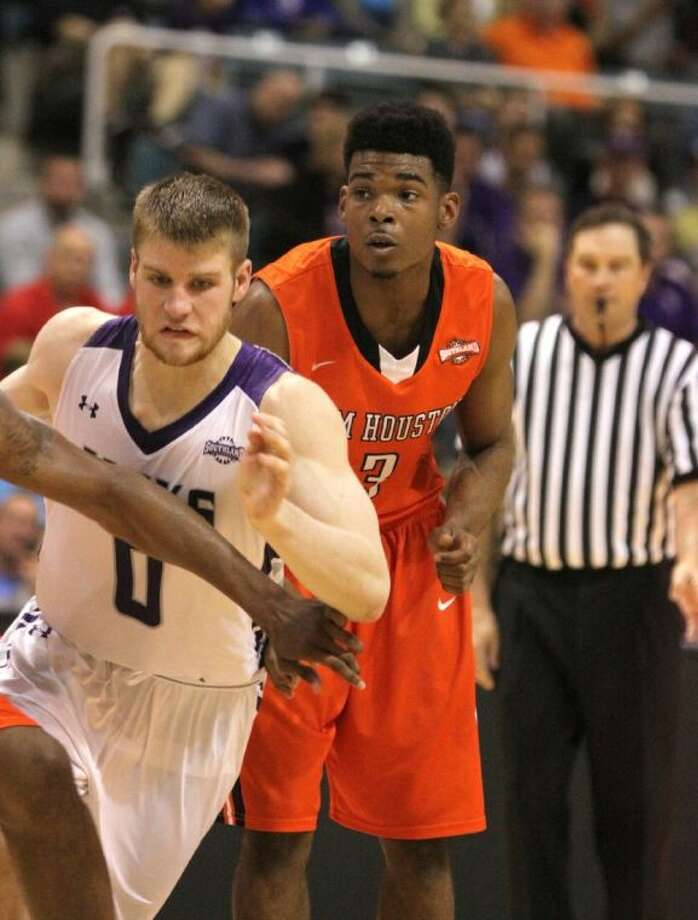 Sam Houston State's Dakarai Henderson (Dawson) and Stephen F. Austin's Thomas Walkup (Deer Park) will meet for the Southland Conference Tournament championship for the second consecutive season. Photo: Staff Photo By Alan Warren