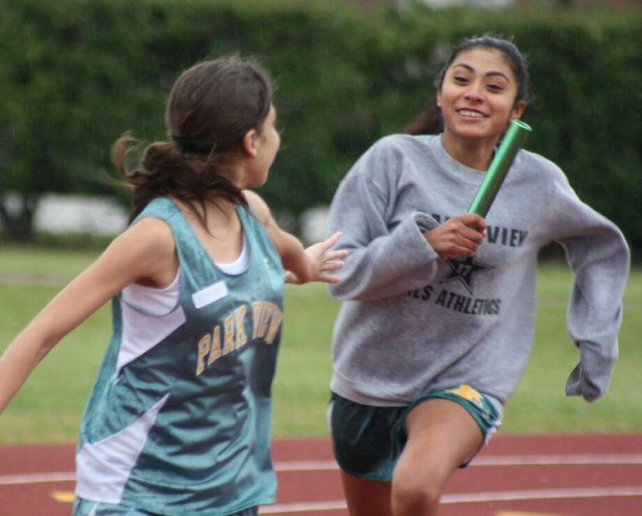 In the rain, Park View Intermediate's Michelle Rodriguez and Alessandra Palma start the final exchange of the baton during Wednesday night's 4 by 100 relay race at Auxiliary Stadium. Park View finished with the time of 1:03.00. The race was one of the last events before the poor weather eventually caused officials to cancel the remainder of the girls meet. Meanwhile, for the second consecutive week, the intermediate school boys' teams had their meet cancelled the next night due to more bad weather. The respective teams will now take spring break off, before holding the district championship meet the following week.