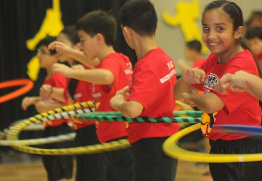 The Hula Hoop routine brings out the smiles and the many body movements that has become famous with every Olympiad. Photo: Robert Avery