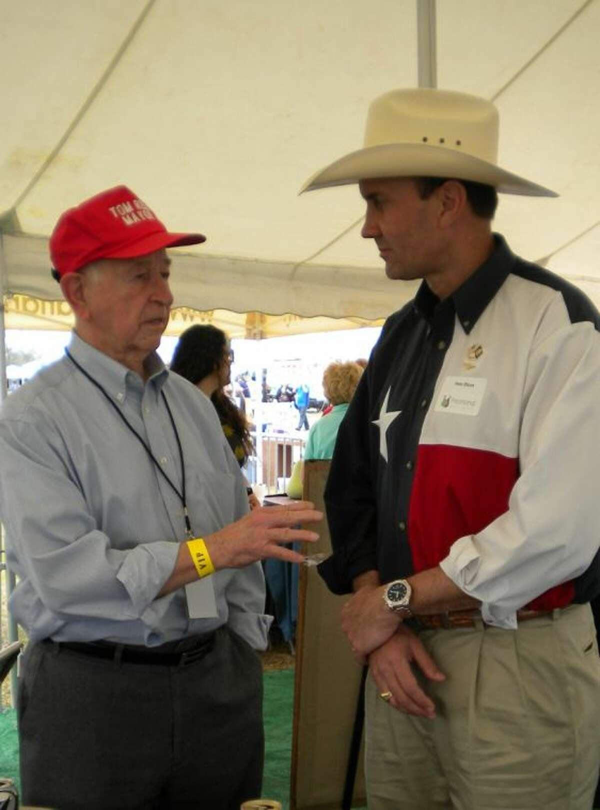 Pearland Mayor Tom Reid, left, talks with U.S. Rep. Pete Olson at a crawfish festival.