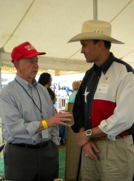 Pearland Mayor Tom Reid, left, talks with U.S. Rep. Pete Olson at a crawfish festival.