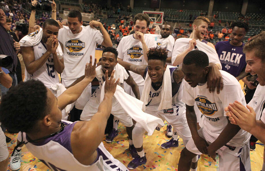 Stephen F. Austin's players dance as they celebrate a victory over Sam Houston State in the Championship game of the Southland Conference Tournament, March 14 at the Merrell Center in Katy. Stephen F. Austin won the game 83-70 to get an automatic bid into the NCAA Tournament. Photo: Staff Photo By Alan Warren