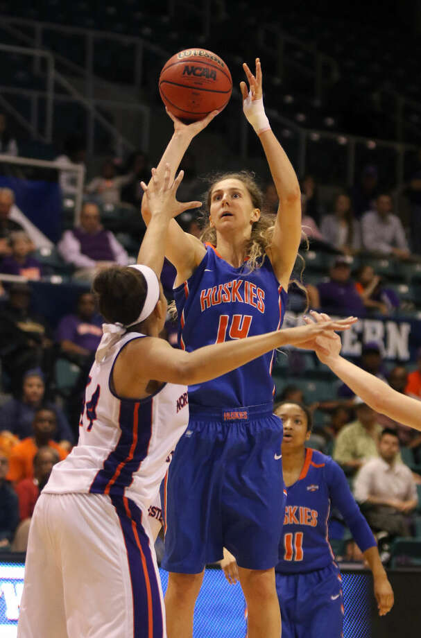 Houston Baptist's Erin McGarrachan shoots over Northwestern State's Tia Youngblood in the Championship game of the Southland Conference Tournament, March 15 at the Merrell Center in Katy. Photo: Staff Photo By Alan Warren