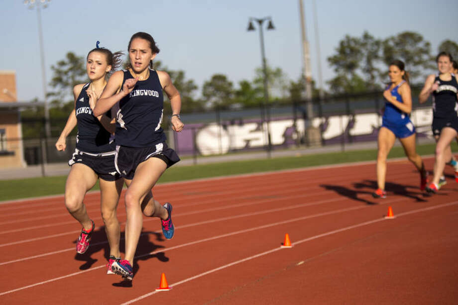 Kingwood's Olivia Thompson and Morgan Livingston compete in the Girls 800 Meter Run during the District 19-4A and 13-5A Championship track meet on April 9, 2014, at Turner Stadium in Humble. (Photo by ANDREW BUCKLEY/The Observer) Photo: ANDREW BUCKLEY