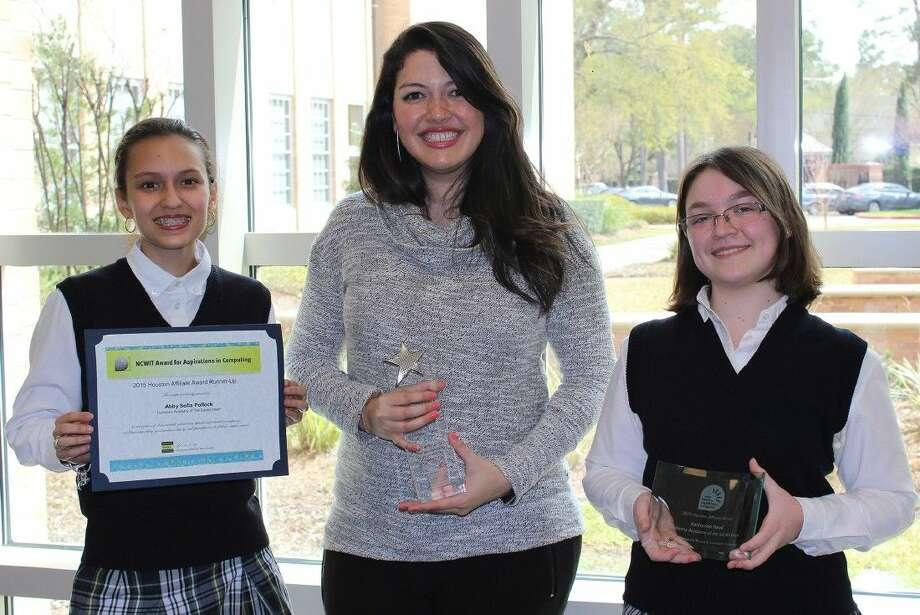 Freshman Abby Sofia Pollock, Duchesne teacher Livia Santos, and Sophomore Kayleigh Head with their awards from NCWIT.