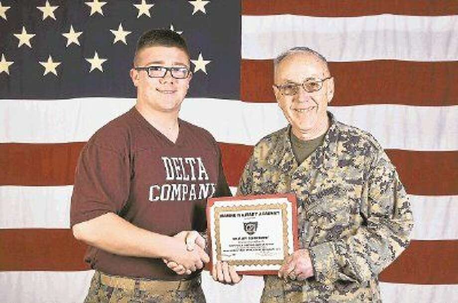 Sophomore Jacob Peyton of Katy, Texas, accepts the Marine Military Academy February 2015 Cadet of the Month award from Superintendent Col. R. Glenn Hill.
