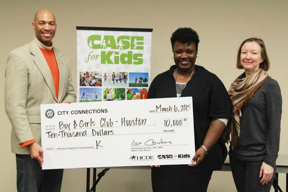 Boys & Girls Club of Houston's Coordinator of Programs and Quality, D'Jomme Adia accepts a check for $10,000 from Council Member Larry Green's Chief of Staff, Donald Perkins and CASE for Kids' Manager of Special Initiatives Mary Glover. Photo: Amanda Arnold