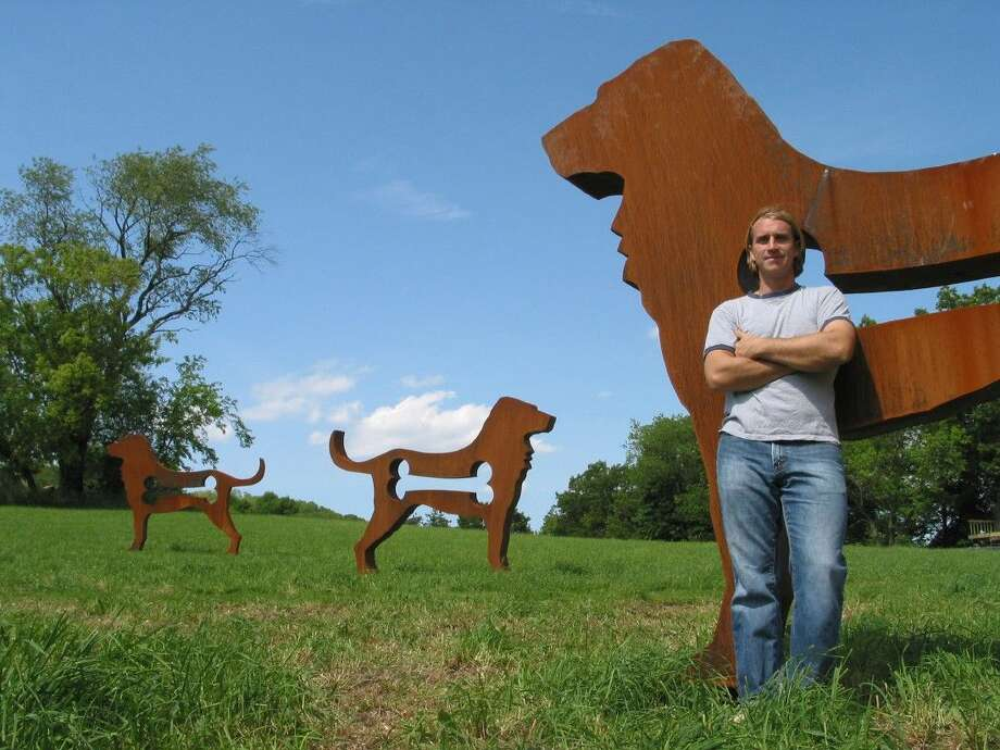 """""""The Big Dog Show"""" will appear in Imperial, Sugar Land's newest master-planned community, April 1 - 15 and Sienna Plantation, April 15 - 30. Rogers' signature piece is a collection of 20, free-standing dogs made of a weathered, Cor-Ten steel. The dogs stand eight feet tall and ten feet wide."""