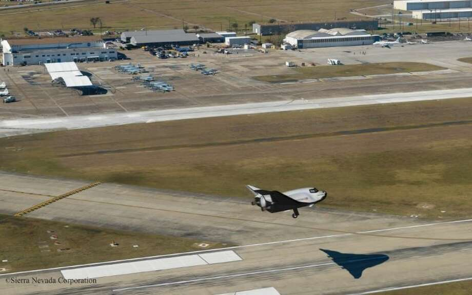 Conceptualized image of SNC's Dream Chaser® spacecraft landing on the runway at Houston's Ellington Field. SNC and the Houston Airport System plan to explore potential applications and multiple economic development opportunities presented by the combination of a Houston-based space port and SNC's Dream Chaser - a spacecraft that can land at the space port directly from low-Earth orbit. Photo Credit: Sierra Nevada Corporation. Photo: Robert Markowitz