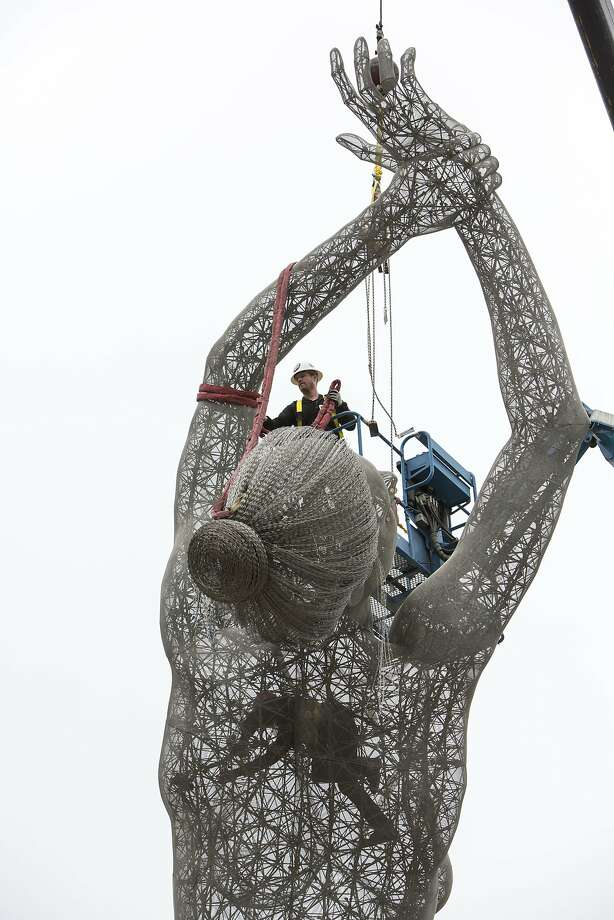 "Artist Marco Cochrane removes the rigging on his sculpture ""Truth is Beauty"" after it was permanently installed at the new San Leandro Tech Campus in San Leandro, Calif., on Monday, October 3, 2016. The sculpture was originally shown in it's final form at Burning Man in 2013 and is the second in a series of three sculptures known collectively as The Bliss Project. Photo: Laura Morton, Special To The Chronicle"