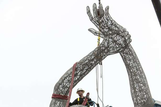 "Artist Marco Cochrane removes the rigging on his sculpture ""Truth is Beauty"" after it was permanently installed at the new San Leandro Tech Campus in San Leandro, Calif., on Monday, October 3, 2016. The sculpture was originally shown in it's final form at Burning Man in 2013 and is the second in a series of three sculptures known collectively as The Bliss Project."