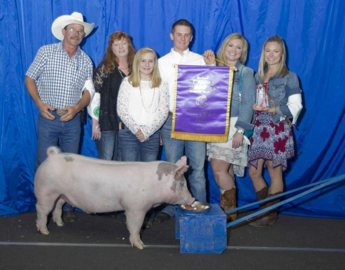 Kelly Carmack's hog was named the Grand Champion during the Junior Livestock Show at the Montgomery County Fair and Rodeo Wednesday. The Willis FFA member's hog was sold for $12,000. Approximately 1,000 exhibitors showed animals, of which 140 were sold at auction.