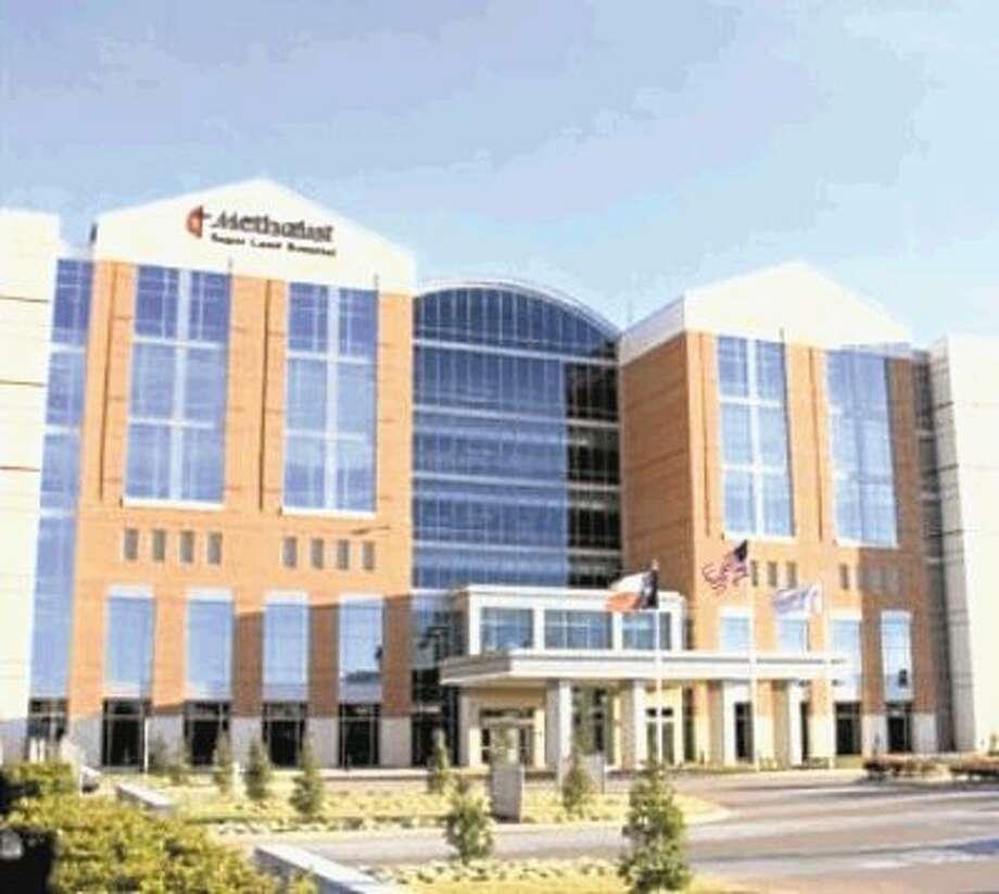 Houston Methodist Sugar Land Hospital lights hospital green