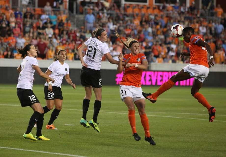 Houston Dash's Osinachi Ohale heads the ball towards the goal against the Portland Thorns during their inaugural match April 12 at BBVA Compass Stadium in Houston. To view or purchase this photo and others like it, go to HCNPics.com Photo: Alan Warren/HCN
