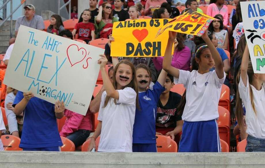 Fans cheer at the inaugural match of the Houston Dash against the Portland Thorns April 12 at BBVA Compass Stadium. To view or purchase this photo and others like it, go to HCNPics.com. Photo: Alan Warren/HCN