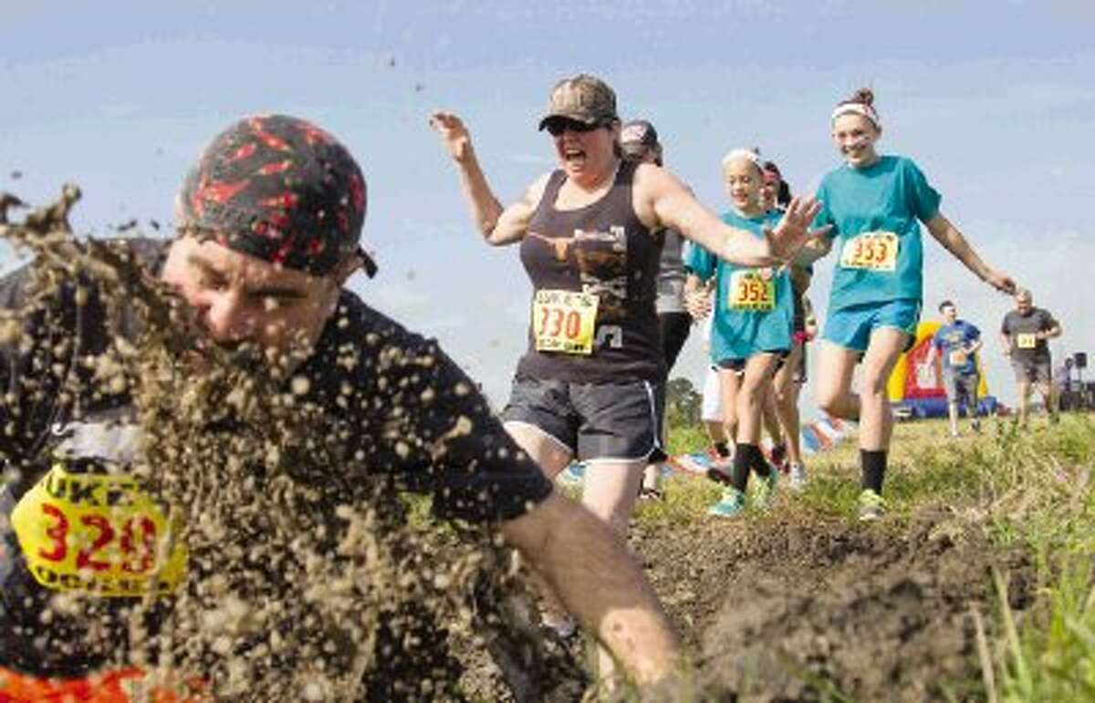 Runners participate in the Montgomery Madness Mud Run at the Buffalo Springs fields near Texas 105 in Montgomery Saturday. Proceeds from the 5K will benefit the MHS seniors' 2014 Project Graduation party. To view or purchase this photo and others like it, visit HCNpics.com.
