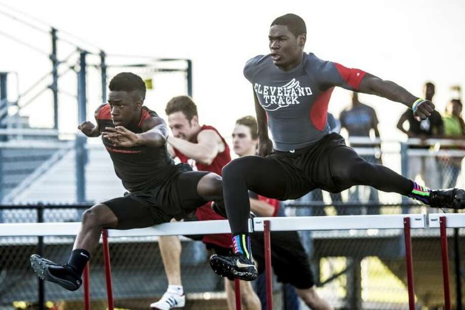 Cleveland's Richard Johnson, right, competes in the Boys 110 Meter Hurdles during the District 22-3A Region III Championship track meet on April 10, 2014, at Falcon Stadium in Huffman. Photo: ANDREW BUCKLEY