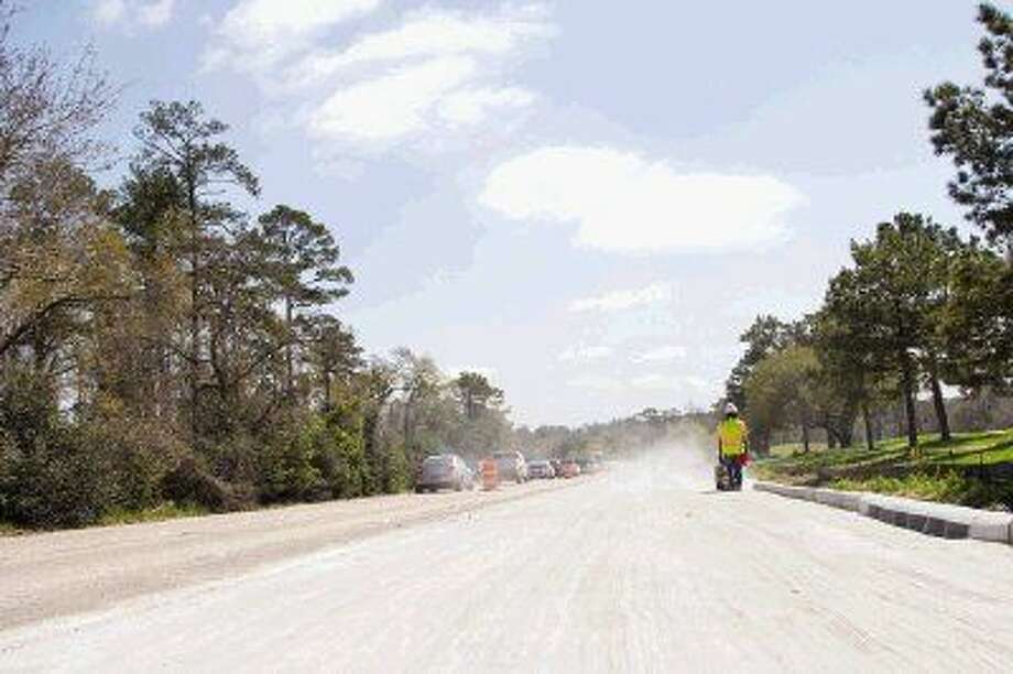 In this March 2014 file photo, construction crews work on widening a segment of the Woodlands Parkway from East Panther Creek Drive to Grogan's Mill Road in The Woodlands. Photo: Staff Photo By Ana Ramirez