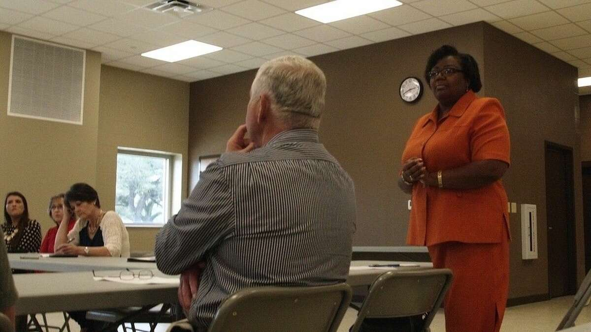 Debra McGinnis, standing, is serving as interim executive director of the Liberty County Housing Authority.