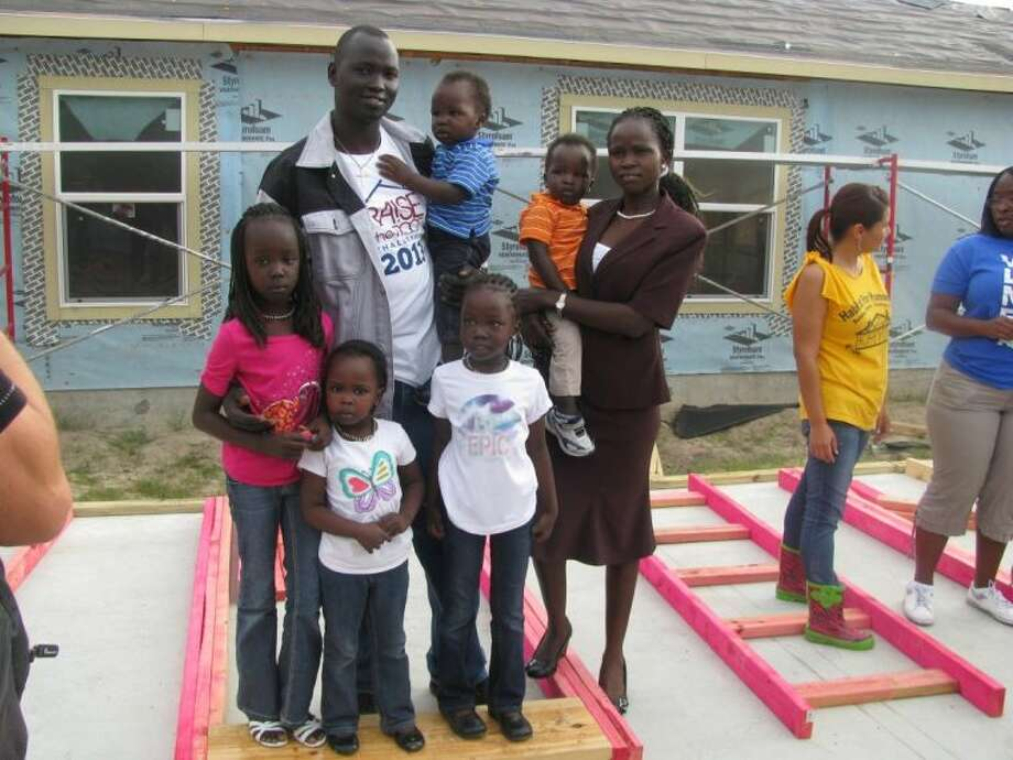 Gabriel Atem and Martha Thieu received keys to their new Habitat for Humanity Northwest Harris County home on Saturday, April 5.