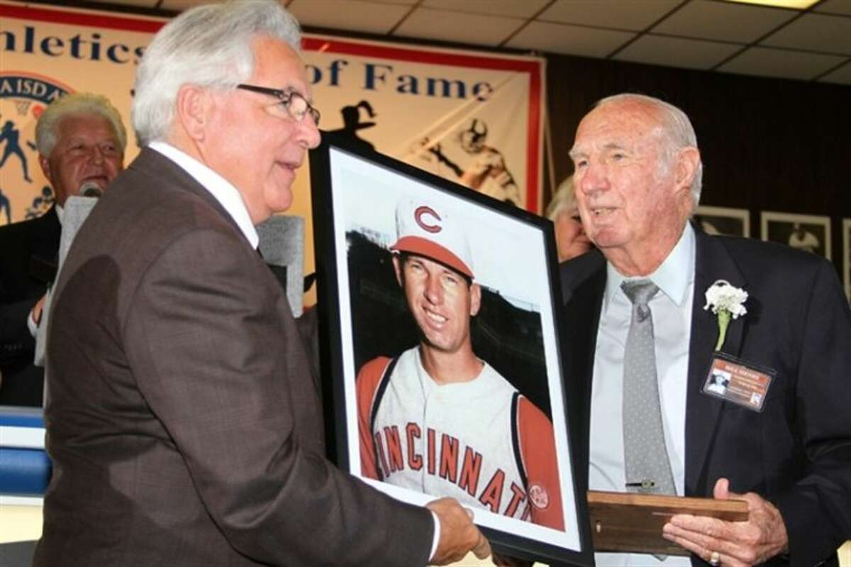 Bill Henry (right) receives his Pasadena ISD Athletics Hall of Fame portrait from Hall of Fame President Terry Brotherton during induction ceremonies in 2012.