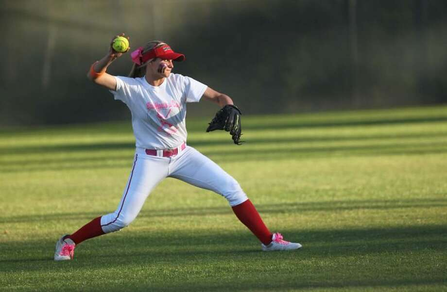 The Woodlands' Amy Cimera (17) throws toward first base during a high school softball game last Tuesday. To view or purchase this photo and others like it, visit HCNpics.com. Photo: Jason Fochtman