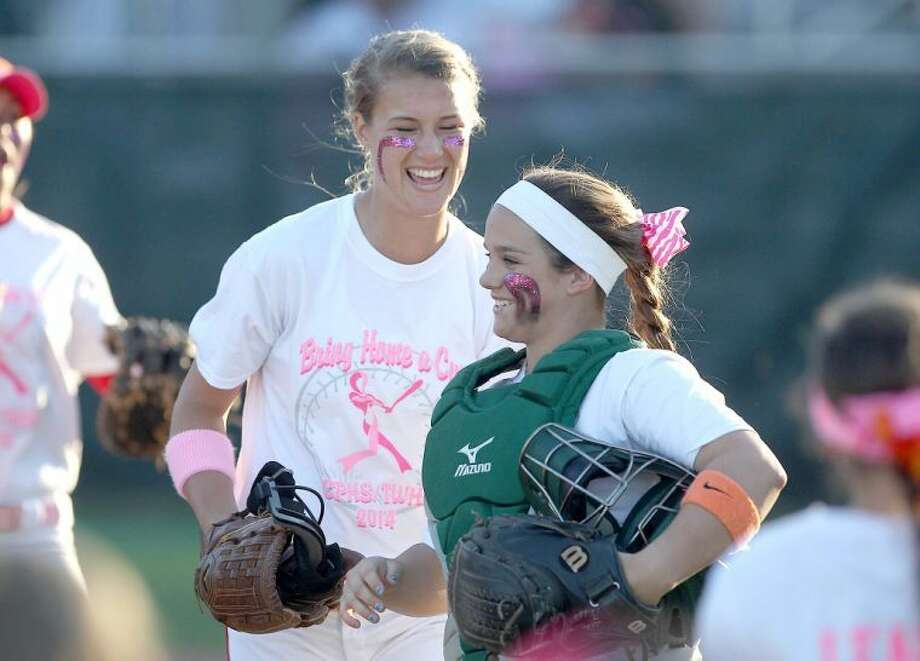 The Woodlands pitcher Abby Langkamp laughs with catcher Kelcy Leach (10) between innings during a high school softball game Tuesday. College Park defeated A&M Consolidated 2-1. To view or purchase this photo and others like it, visit HCNpics.com. Photo: Jason Fochtman