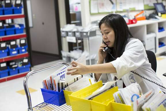 Pharmacist Linh Nguyen-Tran works at the Santa Clara County Better Health Pharmacy in San Jose, Calif., on Monday, October 3, 2016. The pharmacy is the first dedicated drug donation pharmacy in California and just turned a year old. They accept donations of drugs only from regulated health facilities and then dispense them free of charge.