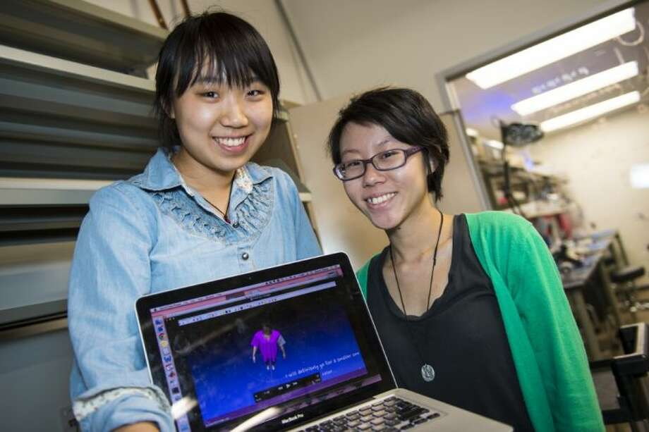 Rice University engineering students Cecilia Zhang, left, and Lam Yuk Wong, have created a virtual fitting room for online shoppers. Their program, which uses Microsoft's Kinect motion-capture device, turns users into virtual mannequins to make online garment fitting more accurate. Photo: Jeff Fitlow