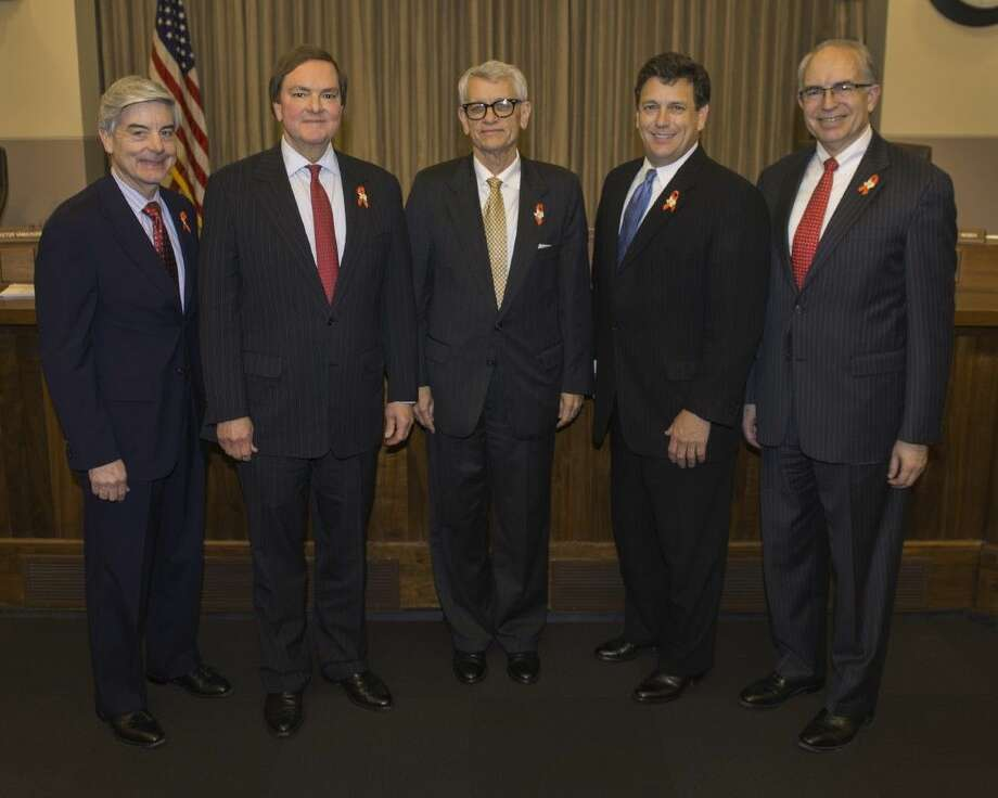 Chairman Tryon Lewis (center) and Commissioner Bruce Bugg (second from left) met yesterday in Austin for their first Texas Transportation Commission meeting. The commission approved the award of the first batch of projects funded by Proposition 1. From left to right: Commissioner Victor Vandergriff; Commissioner Bruce Bugg; Chairman Tryon Lewis; Commissioner Jeff Austin III; and Commissioner Jeff Moseley.