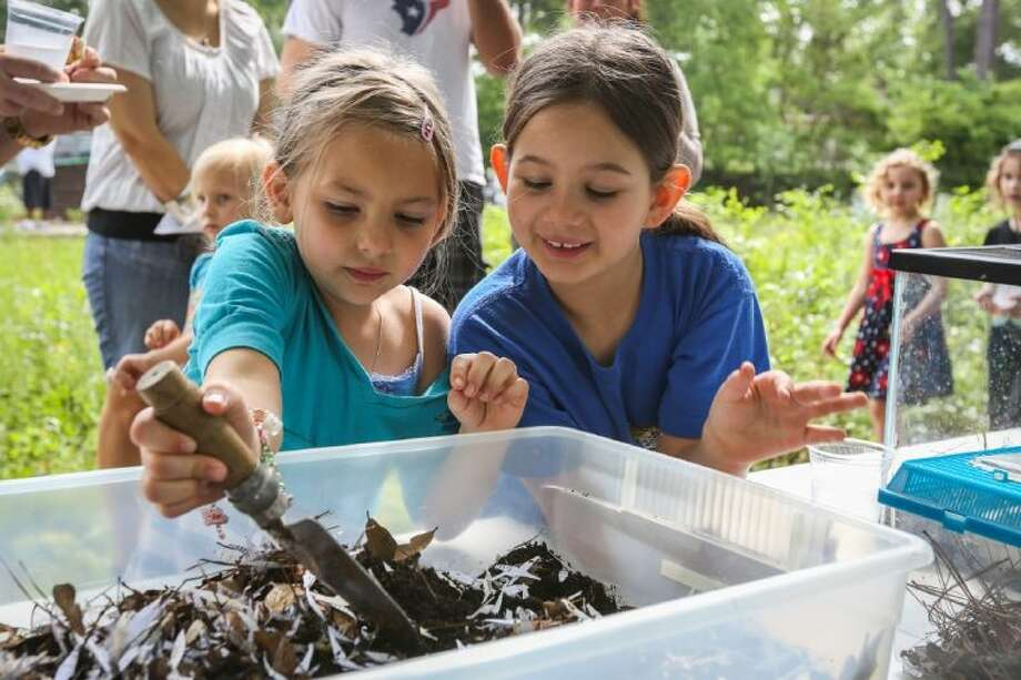 Addyson Rohr, 6, left, and Addison Hollan, 7, right, dig for worms at an educational station during the Earth Day Celebration on Saturday, April 12, at the Cypresswood Water Conservation Garden. To view or purchase this photo and others like it, go to HCNPics.com. Photo: Michael Minasi