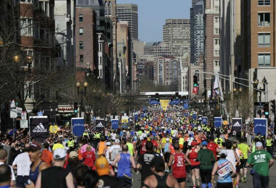 Runners head down Boylston Street to the finish line of the 118th Boston Marathon on Monday.