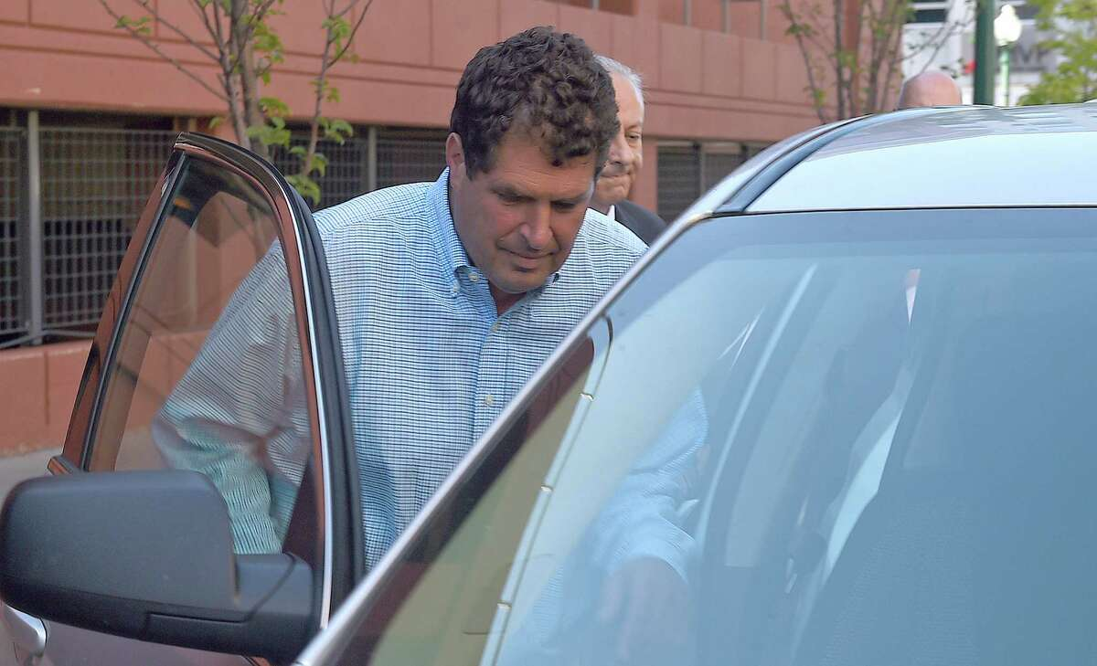 Steven Aiello, the president of COR Development, gets into an waiting car outside the Federal courthouse in Syracuse , New York, Thursday, Sept. 22, 2016. Two owners of COR Development Co., Aiello and Joseph Girardi, face federal corruption charges in U.S. Attorney Preet Bharara's investigation into economic development projects in Upstate New York. Aiello and Gerardi are accused of bribing a former top aide to Gov. Andrew Cuomo. (Dennis Nett/syracuse.com via AP)