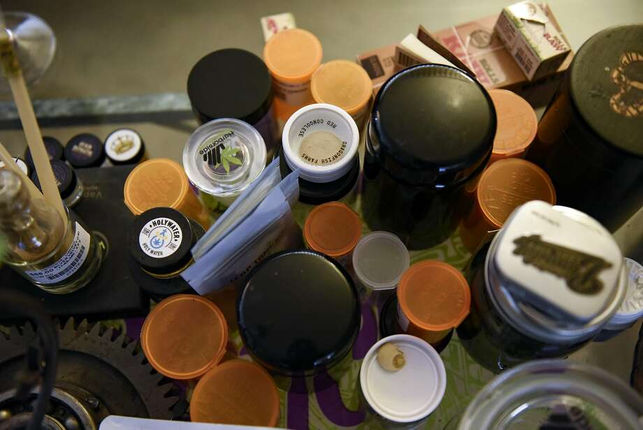 A pile of marijuana containers are on a coffee table of cannabis entrepreneur Terryn Buxton's Oakland home. Photo: Michael Short, Special To The Chronicle