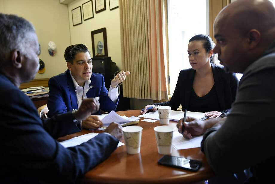 Robert Brackens (left) of the civic group 100 Black Men and Cannabis Regulatory Commission member Terryn Buxton (right) meet with Oakland Councilwoman Rebecca Kaplan (second left) and her chief of staff, Sheng Thao. Photo: Michael Short, Special To The Chronicle