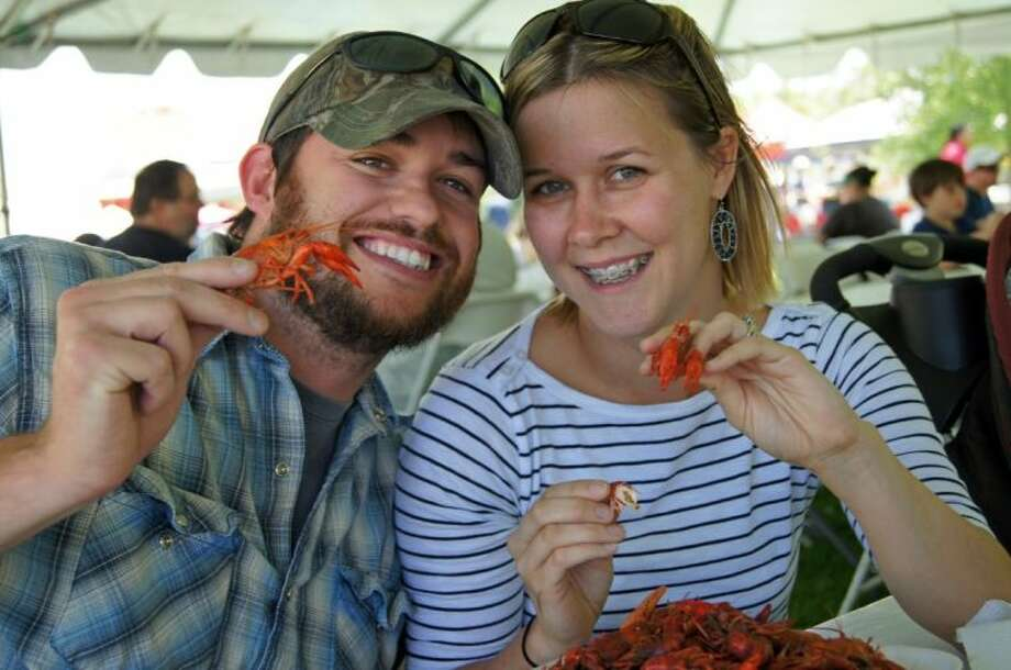 Mike and Amber Davis of Pinehurst enjoy the mudbugs and the Rails and Tails Mudbug Festival. The 2014 event is set for May 3-4 from 11 a.m. to 6:30 p.m. in downtown Tomball. Photo: Submitted