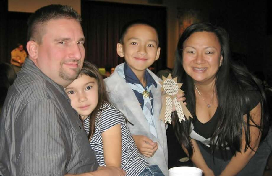 The Prill family attends aBlue and Gold banquet Cub Scout banquet.